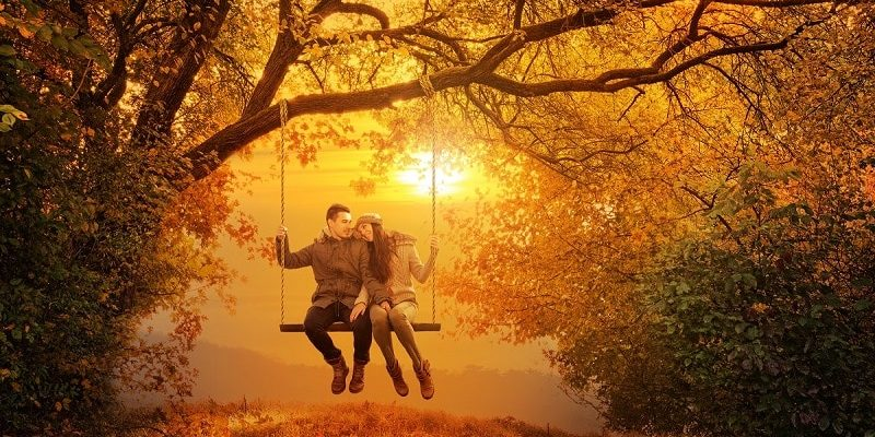 20-Minute Marriage Makeover Step 3: Get and follow the step-by-step checklist to earn the marriage you deserve (man and wife in the park sitting on a swing hugging)